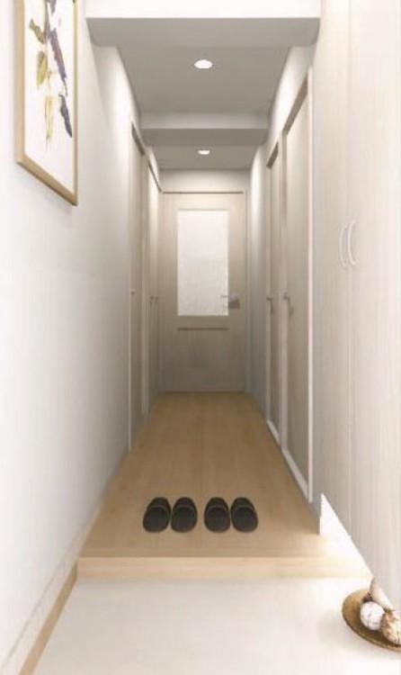 フロート仕様の間接照明が幻想的な雰囲気を作り出す明るく、清潔感のある玄関