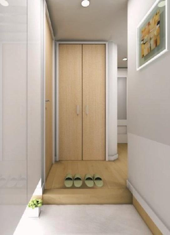 フロート仕様の間接照明が幻想的な雰囲気を作り出す、明るく清潔感のある玄関です