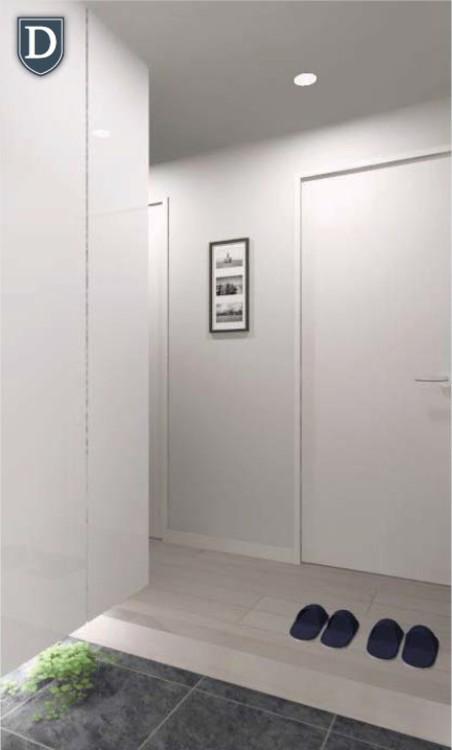 住まいの第一印象を決める玄関には間接照明とホワイト鏡面の下足入を使用し、高級感と清潔感を演出