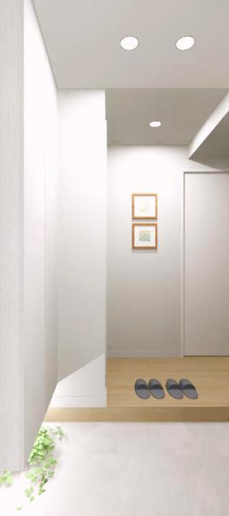 住まいの第一印象を決める玄関スペースには間接照明とホワイトアッシュの下足入を使用し、清潔感を演出